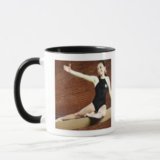 Female gymnast practicing on a balance beam and mug