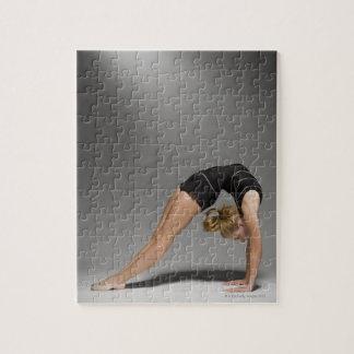 Female gymnast stretching, studio shot 2 puzzle