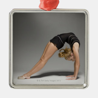 Female gymnast stretching, studio shot 2 Silver-Colored square decoration