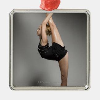 Female gymnast stretching, studio shot christmas tree ornaments