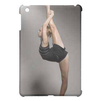 Female gymnast stretching, studio shot iPad mini cases