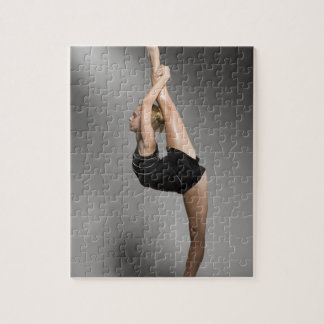 Female gymnast stretching, studio shot jigsaw puzzle