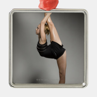 Female gymnast stretching, studio shot Silver-Colored square decoration