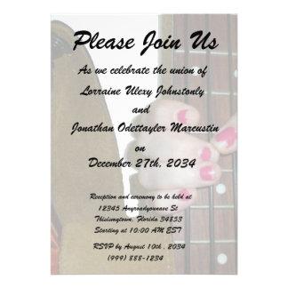female hand holding four string bass neck invite