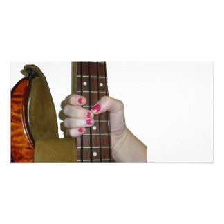 female hand holding four string bass neck photo cards
