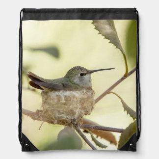 Female hummingbird on her nest drawstring bag