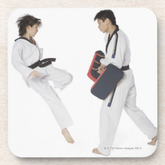 Female karate instructor teaching martial arts coaster