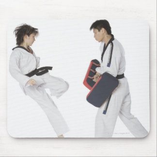 Female karate instructor teaching martial arts mouse mat