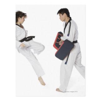 Female karate instructor teaching martial arts postcard