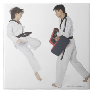 Female karate instructor teaching martial arts tile