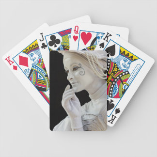 Female mime performing on street corner bicycle playing cards