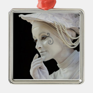 Female mime performing on street corner christmas ornament