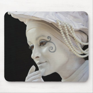 Female mime performing on street corner mouse mat