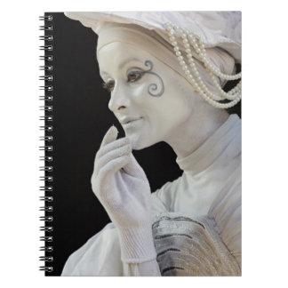 Female mime performing on street corner notebook