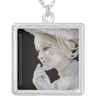 Female mime performing on street corner silver plated necklace