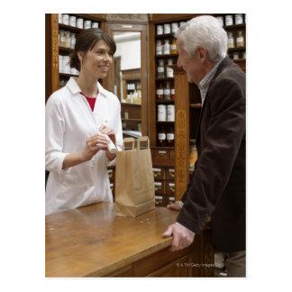 Female pharmacist advising customers postcard