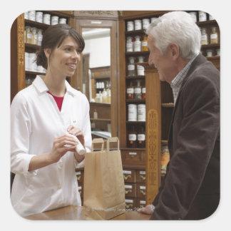 Female pharmacist advising customers square sticker
