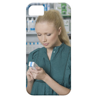 Female pharmacist looking at medicine in 2 iPhone 5 cover