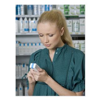 Female pharmacist looking at medicine in 2 postcard
