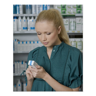 Female pharmacist looking at medicine in 2 poster