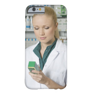Female pharmacist looking at medicine in barely there iPhone 6 case