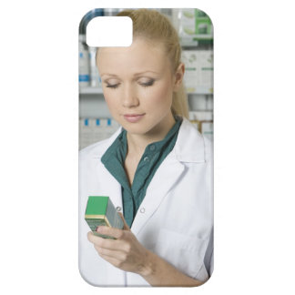 Female pharmacist looking at medicine in case for the iPhone 5