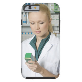 Female pharmacist looking at medicine in tough iPhone 6 case