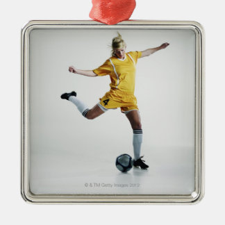 Female soccer player preparing to kick soccer christmas ornament