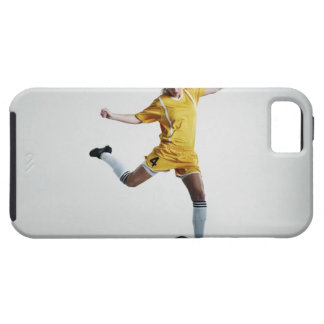 Female soccer player preparing to kick soccer iPhone 5 cover