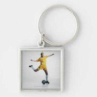 Female soccer player preparing to kick soccer Silver-Colored square key ring