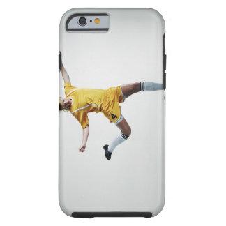 Female soccer player preparing to kick soccer tough iPhone 6 case