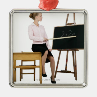 Female Teacher Pointing Ruler at Chalkboard Silver-Colored Square Decoration
