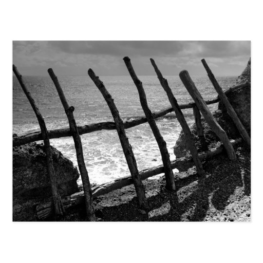 Fence and ocean postcard