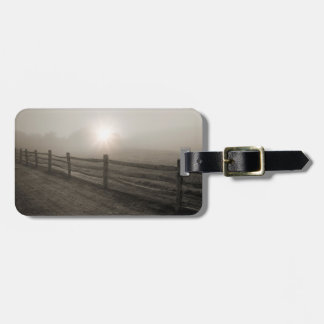 Fence and Sunburst Through Fog near Sharon Luggage Tag