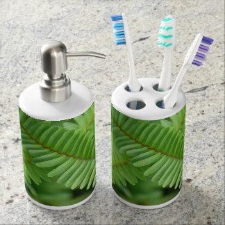 Fern design on toothbrush & soap holder. soap dispenser and toothbrush holder
