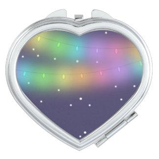 Festive lights and falling snow Pocket Mirror