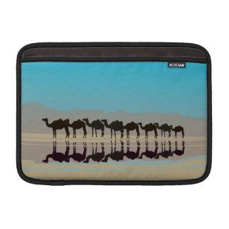 Few camels walking in desert MacBook sleeve