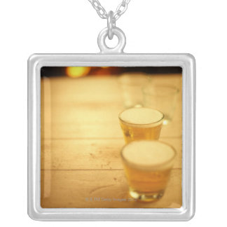Few glasses of beer square pendant necklace