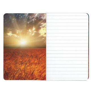 Field of wheat and sunset journal
