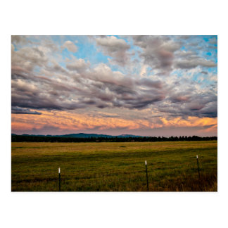 Fields, mountains, and sky postcard