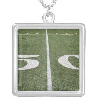 Fifty yard line pendants