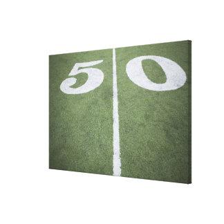 Fifty yard line on sports field canvas print