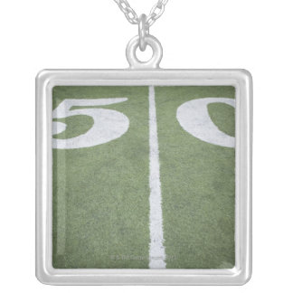Fifty yard line on sports field silver plated necklace