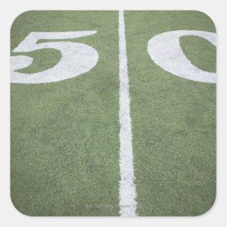 Fifty yard line on sports field square sticker
