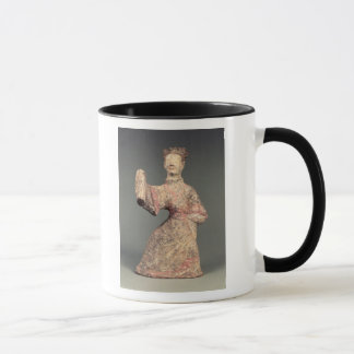 Figure of a male dancer, tomb artefact mug