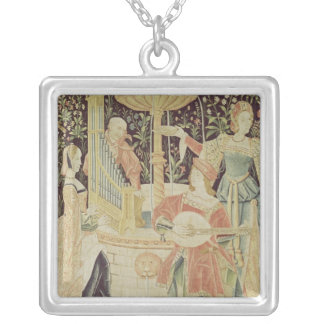 Figures around a fountain silver plated necklace