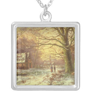 Figures on a path before a village in winter silver plated necklace