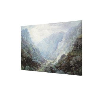 Figures Resting On The Pathway Through A Rocky Gor Canvas Print