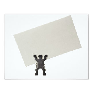 Figurine holding a piece of blank business card 11 cm x 14 cm invitation card