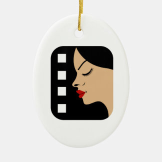 Filmstrip with side view of a woman christmas ornament